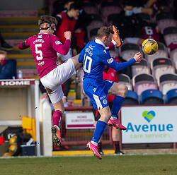 06MAR21 Arbroath's Thomas O'Brien ands Queen of the South's Connor Shields. Arbroath 2 v 4 Queen of the South, Scottish Championship played 6/3/2021 at Arbroath's home ground, Gayfield Park.