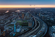 Nederland, Noord-Holland, Amsterdam, 16-01-2014; zicht op de Zuidas en de Ring A10 in de avondschemering en bij ondergaande zon. Omgeving Station Zuid-WTC, World Trade Centre (WTC) en hoofdkantoor ABN-AMRO, Ernst & Jong.<br /> Verder in beeld de woontorens Symphony 1 en 2 (onderdeel Gershwin), de Vinoly-toren en Ito-toren (onderdeel Mahler4), Atrium.<br /> Zuid-as, 'South axis', financial center in the South of Amsterdam, with o.a. headquarters of former ABN AMRO, World Trade Centre (WTC) en Ring Road A10. Amsterdam equivalent of 'the City', financial district. <br /> luchtfoto (toeslag op standaard tarieven);<br /> aerial photo (additional fee required);<br /> copyright foto/photo Siebe Swart.<br /> aerial photo (additional fee required);<br /> copyright foto/photo Siebe Swart.