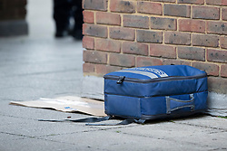 © Licensed to London News Pictures. 10/07/2020. London, UK. A police Forensics Bag at a crime scene near Crossharbour DLR station in Poplar. Police were called shortly after 18:00hrs to reports of two males injured at Alexia Square, E14 close to Crossharbour DLR station. Officers attended and found a man, believed aged in his late teens or early 20s, suffering stab injuries. Emergency services provided first aid but despite their efforts, he was pronounced dead at the scene. A second male, believed aged in his late teens, was taken by the LAS to an east London hospital. Photo credit: George Cracknell Wright/LNP