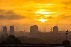Acton, London, September 28th 2016. Distant skyscrapers in the city appear through the haze as a new day dawns in London, photographed from the A40 in Acton.