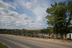 Harefield, UK. 13 July, 2020. Ground clearance work in the Colne Valley for the HS2 high-speed rail link. A large area of trees, including a huge oak tree, has recently been cleared on the other side of the road. Thousands of trees have already been felled for the project in the Colne Valley.