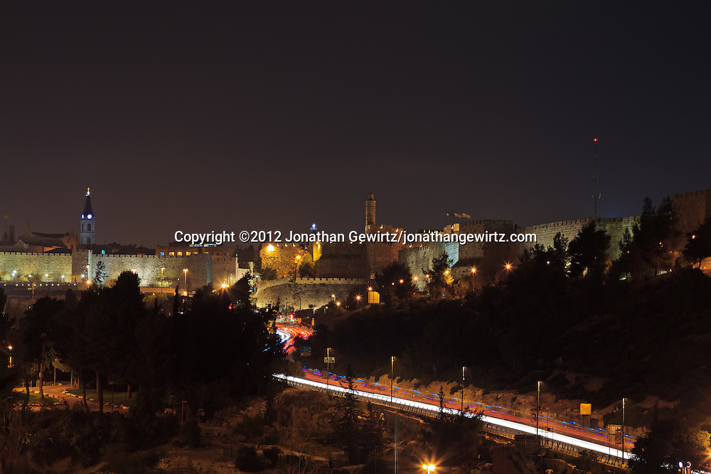 Night traffic on Hativat Yerushalayim and Jaffa Street passes the Sultan's Pool on the way to the Jaffa Gate in Jerusalem's Old City. WATERMARKS WILL NOT APPEAR ON PRINTS OR LICENSED IMAGES.