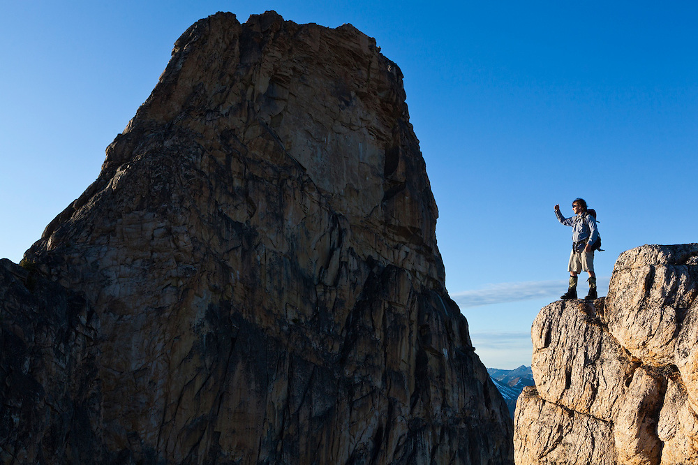 Kevin Steffa stands on a narrow ridge facing the East Face of Golden Horn, Okanogan National Forest, Washington.