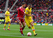 Antony Kay (Milton Keynes Dons) keeps the ball from Diego Fabbrini (Middlesbrough FC)  during the Sky Bet Championship match between Middlesbrough and Milton Keynes Dons at the Riverside Stadium, Middlesbrough, England on 12 September 2015. Photo by George Ledger.