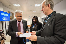 9 December 2019, Madrid, Spain: Religious leaders from a variety of faiths meet to hand over an interfaith declaration to Ovais Sarmad, deputy executive secretary of the UNFCCC, at COP25. Here, Henrik Grape from Church of Sweden and the World Council of Churches (right) hands over the declaration.
