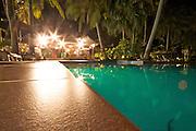 Nightime shot of the infinity pool and bar at Iririki Island Resort in Port Vila, Vanuatu.