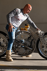Rafik Kaissi sits on his Bearing Bike, which is an actual motorcycle that may hit most as a very original piece of art. The main part of the bike is a large bearing that holds the Honda CR500 engine and uses an Ohlins shock mounted on top to offer suspension. The front end and rear swingarm are mounted to the inside and outside of the main bearing, which creates the suspension for the bike. At the Handbuilt Show. Austin, Austin USA. Sunday, April 14, 2019. Photography ©2019 Michael Lichter.