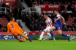 Stoke City's Tom Ince (centre) scores his side's first goal