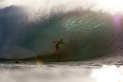 PEARL CITY, HI - NOVEMBER 14: A surfer comes out of a barrel at Pipeline on November 14, 2010 on the North Shore of Oahu, Hawaii.  (Photo by Matt Roberts/Getty Images)