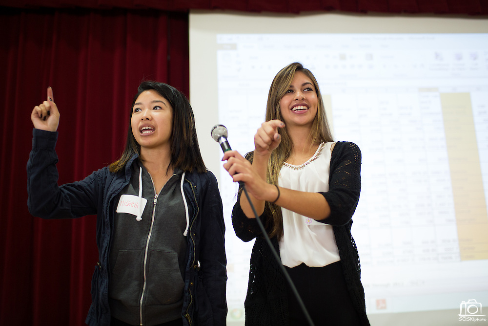 Michelle Nguyen, 17, and Tatiana Coria, 17, (right) of Milpitas High School break the ice with students during the Jack Emery Food Drive luncheon at Milpitas Community Center in Milpitas, California, on November 4, 2014. (Stan Olszewski/SOSKIphoto)