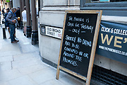 On the day that it was announced that the Coronavirus lockdown measures are set to ease even further, drinkers outside a pub in the City of London enjoy some take out drinks at The Phoenix pub on 23rd June 2020 in London, England, United Kingdom. The government has relaxed its lockdown rules, and from early July is allowing spubs to reopen, as long as they have set up social distancing systems.