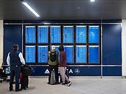 17 FEBRUARY 2020 - ATLANTA, GEORGIA:   Passengers check flight times and status in Atlanta's Hartsfield–Jackson Atlanta International Airport, the world's busiest airport by passenger count.  PHOTO BY JACK KURTZ