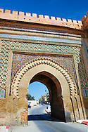Moorish Arabesque Gate in the city walls of Meknes with zellij mosaics, Morocco .<br /> <br /> Visit our MOROCCO HISTORIC PLAXES PHOTO COLLECTIONS for more   photos  to download or buy as prints https://funkystock.photoshelter.com/gallery-collection/Morocco-Pictures-Photos-and-Images/C0000ds6t1_cvhPo<br /> .<br /> <br /> Visit our ISLAMIC HISTORICAL PLACES PHOTO COLLECTIONS for more photos to download or buy as wall art prints https://funkystock.photoshelter.com/gallery-collection/Islam-Islamic-Historic-Places-Architecture-Pictures-Images-of/C0000n7SGOHt9XWI