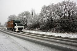 © Licensed to London News Pictures. 03/12/2020. Llanfihangel Nant Melan, Powys, Wales, UK. Vehicles drive along the A44 as heavy snow falls near Llanfihangel Nant Melans in Powys, UK. Photo credit: Graham M. Lawrence/LNP