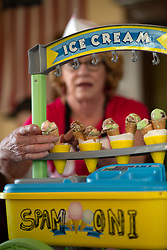 """Rae Fleming of Santa Cruz, Calif. lines up cones filled with her """"Spamoni"""" ice cream, at the 22nd annual Spam Festival, Sunday, Feb. 16, 2019, in Isleton, Calif. Spam lovers competed for prizes by presenting their favorite Spam-infused foods, or entering the Spam-eating and Spam-toss contests. (Photo by D. Ross Cameron)"""