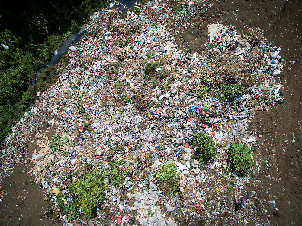 Aerial view of Bitung City landfill with Lembeh Island in the background.