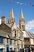 Spires of cathedral rise above historic town centre buildings, Truro, Cornwall, England, UK
