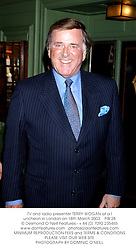 TV and radio presenter TERRY WOGAN at a luncheon in London on 18th March 2003.PIB 28