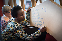 24 July 2018, Amsterdam, the Netherlands: Religious leaders share expressions of hope, testominies, challenges and steps ahead for a coordinated HIV response. They write their messages on a symbolic bridge, built as a token of hope for collaboration within and between faiths, and between faith and other sectors. On 23-27 July 2018 in Amsterdam, the Netherlands, the World Council of Churches - Ecumenical Advocacy Alliance in collaboration with faith and other partners hosts an Interfaith Networking Zone in the International AIDS Conference's Global Village area, providing a dynamic space for exchanges, resources and workshops. The Global Village is an integral part and recurring feature of the International AIDS Conference, and offers an accessible venue intended to strengthen the connection between the international conference and the local hosting community.
