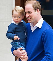 © London News Pictures. 02/05/2015. Prince William returns to  the Lindo Wing of St Mary's hospital in London holding his son Prince George, following the birth of his new born baby daughter, Princess of Cambridge. Photo credit: Ben Cawthra /LNP