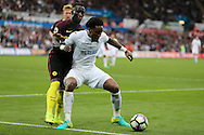 Leroy Fer of Swansea city shields the ball from Bacary Sagna of Manchester city. Premier league match, Swansea city v Manchester city at the Liberty Stadium in Swansea, South Wales on Saturday 24th September 2016.<br /> pic by Andrew Orchard, Andrew Orchard sports photography.