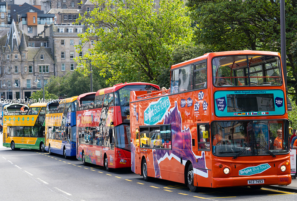 Row of double decker bus tour buses in central Edinburgh, Scotland UK