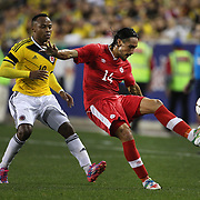 Issey Nakajima-Farran, Canada, in action during the Colombia Vs Canada friendly international football match at Red Bull Arena, Harrison, New Jersey. USA. 14th October 2014. Photo Tim Clayton
