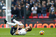 Harry Kane of Tottenham Hotspur on the ground in pain after being fouled by Timothy Fosu-Mensah of Crystal Palace. Premier league match, Tottenham Hotspur v Crystal Palace at Wembley Stadium in London on Sunday 5th November 2017.<br /> pic by Steffan Bowen, Andrew Orchard sports photography.