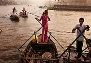 Water taxis wait for passengers on two waterways that create a perfect cross-shaped intersection in Soc Trang. The taxis link the town which is intersected by the waterways. Robert Dodge, a Washington DC photographer and writer, has been working on his Vietnam Unexpected project since 2005. The project has taken him throughout Vietnam, including Hanoi, Ho Chi Minh City (Saigon), Nha Trang, Mue Nie, Phan Thiet, the Mekong, Sapa, Ninh Binh and the Perfume Pagoda. His images capture scenes and people from women in conical hats planting rice along the Red River in the north to men and women working in the floating markets one the Mekong River and its tributaries. Robert's project also captures the traditions of ancient Asia in the rural markets, Buddhist Monasteries and the celebrations around Tet, the Lunar New Year. Also to be found are images of the emerging modern Vietnam, such as young people eating and drinking and embracing the fashions and music of the west. Robert Dodge, a Washington DC photographer and writer, has been working on his Vietnam Unexpected project since 2005. The project has taken him throughout Vietnam, including Hanoi, Ho Chi Minh City (Saigon), Nha Trang, Mue Nie, Phan Thiet, the Mekong, Sapa, Ninh Binh and the Perfume Pagoda. His images capture scenes and people from women in conical hats planting rice along the Red River in the north to men and women working in the floating markets one the Mekong River and its tributaries. Robert's project also captures the traditions of ancient Asia in the rural markets, Buddhist Monasteries and the celebrations around Tet, the Lunar New Year. Also to be found are images of the emerging modern Vietnam, such as young people eating and drinking and embracing the fashions and music of the west.
