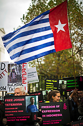 © London News Pictures. 31/10/2012. London, UK.  Demonstrators holding banners during a protest outside Downing Street, London against alleged human rights abuses committed by Indonesia's government against West Papuan tribespeople. The President of Indonesia, Susilo Bambang Yudhoyono, is currently on a state visit to the UK.  Photo credit: Ben Cawthra/LNP