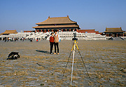 Chinese people taking souvenir photograph at the Forbidden City in Tiananmen Square in Peking, now Beijing, China in the 1980s