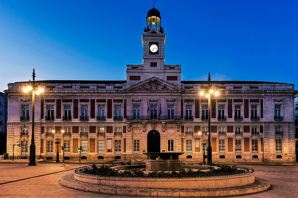 Clock tower on the Ministry of the Interior building, Puerta del Sol, Madrid, Spain