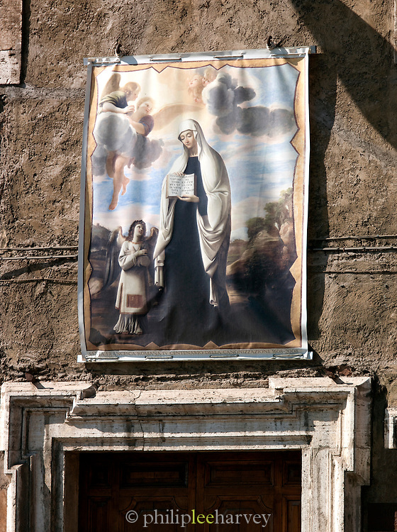 Poster of painting above building on Via della Teatro, Rome, Italy