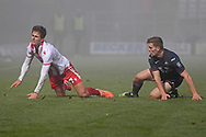 Swansea City defender Cameron Evans(38) commits a foul on Stevenage midfielder Charlie Carter(7) during the FA Cup match between Stevenage and Swansea City at the Lamex Stadium, Stevenage, England on 9 January 2021.