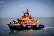 The Royal National Lifeboat Institution RNLI Dover Life boat 17-09 arriving into Folkestone Harbour, Folkestone, Kent. UK. 6th August 2016.