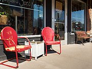 "26 APRIL 2020 - JEWELL, IOWA: Chairs and a table in front of a coffee shop in Jewell that is closed because of the COVID-19 pandemic. Jewell, a small community in central Iowa, became a food desert when the only grocery store in town closed in 2019. It served four communities within a 20 mile radius of Jewell. Some of the town's residents are trying to reopen the store, they are selling shares to form a co-op, and they hold regular fund raisers. Sunday, they served 550 ""grab and go"" pork roast dinners. They charged a free will donation for the dinners. Despite the state wide restriction on large gatherings because of the COVID-19 pandemic, the event drew hundreds of people, who stayed in their cars while volunteers wearing masks collected money and brought food out to them. Organizers say they've raised about $180,000 of their $225,000 goal and they hope to open the new grocery store before summer.     PHOTO BY JACK KURTZ"