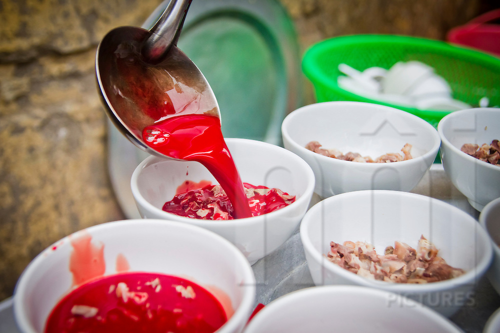 Pig blood soup being served on the street in Hanoi, Vietnam, Asia