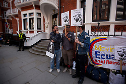 © Licensed to London News Pictures. 20/06/2012. LONDON, UK. Protesters are seen outside the Ecuadorian Embassy in London where Wikileaks founder Julian Assange is staying whilst seeking asylum. Assange, who has fought extradition to Sweden over alleged sex crimes, may be arrested if he is not granted asylum due to breaching the terms of his bail agreement. Photo credit: Matt Cetti-Roberts/LNP