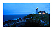 The classic Pemaquid Point Lighthouse holding vigil in the post sunset twilight of a stormy New England autumn day, Bristol Maine, USA