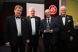 CARDIFF, WALES - Wednesday, November 11, 2009: Wales' Ken Jones (ex-Wales 1958 World Cup Squad goalkeeper) receives his special award with SA Brains' Chairman John Rhys, President Phil Pritchard and General Secretary David Collins during the Football Association of Wales Player of the Year Awards hosted by Brains SA at the Cardiff City Stadium. (Pic by David Rawcliffe/Propaganda)