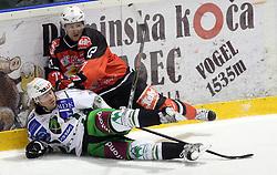 Matej Hocevar vs Uros Vidmar at 52nd round of EBEL league ice hockey match between HK Acroni Jesenice and HDD Tilia Olimpija, on January 29, 2009, in Podmezaklja, Jesenice, Slovenia. Acroni Jesenice won 5:3. (Photo by Vid Ponikvar / Sportida)