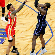 ORLANDO, FL - MARCH 03: Dwayne Bacon #8 of the Orlando Magic attempts a shot over John Collins #20 of the Atlanta Hawks during the first half at Amway Center on March 3, 2021 in Orlando, Florida. NOTE TO USER: User expressly acknowledges and agrees that, by downloading and or using this photograph, User is consenting to the terms and conditions of the Getty Images License Agreement. (Photo by Alex Menendez/Getty Images)*** Local Caption *** Dwayne Bacon; John Collins