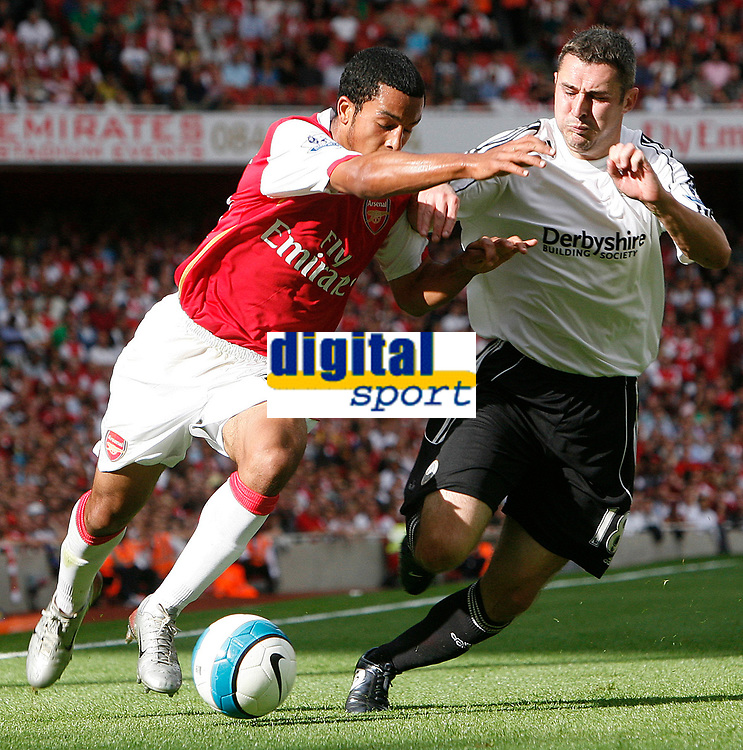Photo: Steve Bond.<br />Arsenal v Derby County. The FA Barclays Premiership. 22/09/2007. Theo walcott (L) takes on Andy Griffin (R)