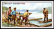Raising platinum-bearing gravels from river beds such as that of the Tura and other rivers in the Urals, Russia. From 'Mining' a set of cigarette cards published by WD & HO Wills, 1916.