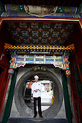 Qiongdao (Jade Island) in Beihai Lake. Fangshan Imperial Food Restaurant. Chef and circular gate.