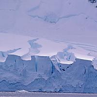 ANTARCTICA, Crevasses and calving seracs on coastal glacier, Anvers Island, South Shetland Islands.