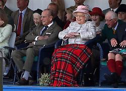 The Duke of Edinburgh and Queen Elizabeth II attend the Braemar Royal Highland Gathering at the Princess Royal and Duke of Fife Memorial Park, Braemar.