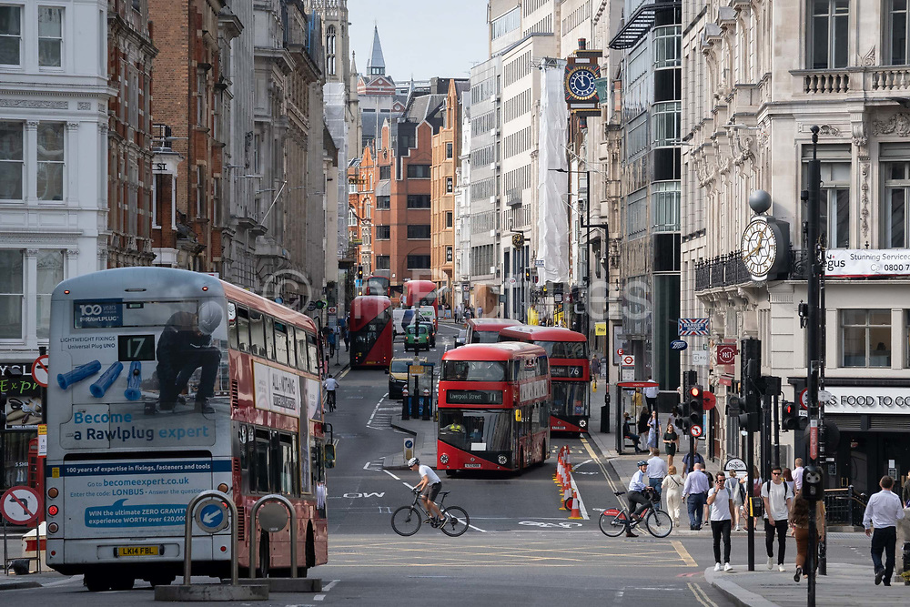 Looking westwards from Ludgate Hill towards Fleet Street at the busy traffic junction of the Farringdon Road in the City of London, on 16th September 2020, in London, England.