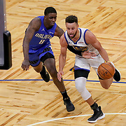 ORLANDO, FL - FEBRUARY 19:  Stephen Curry #30 of the Golden State Warriors dribbles past Dwayne Bacon #8 of the Orlando Magic during the second half at Amway Center on February 19, 2021 in Orlando, Florida. NOTE TO USER: User expressly acknowledges and agrees that, by downloading and or using this photograph, User is consenting to the terms and conditions of the Getty Images License Agreement. (Photo by Alex Menendez/Getty Images)*** Local Caption *** Stephen Curry; Dwayne Bacon