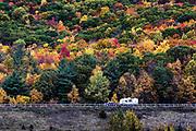RV camper on an autumn road trip, Castleton, New York, USA
